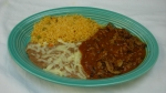 Chile Colorado - Chunks of steak grilled and cooked with hot sauce, rice, beans and tortillas.
